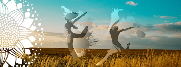 Summer woman dancing and jumping in the meadow