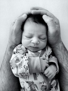 Dad holding a baby sleeping