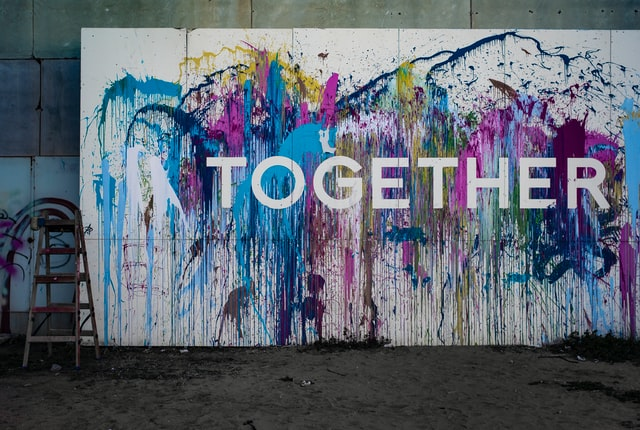 together written on colorful background