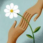 joined hands under white flower